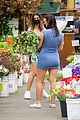 emily ratajkowski cradles her growing baby bump shopping for flowers 04
