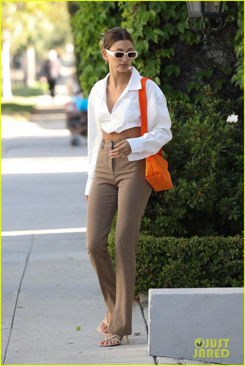 hailey bieber shows of toned midriff for business meeting 034552718