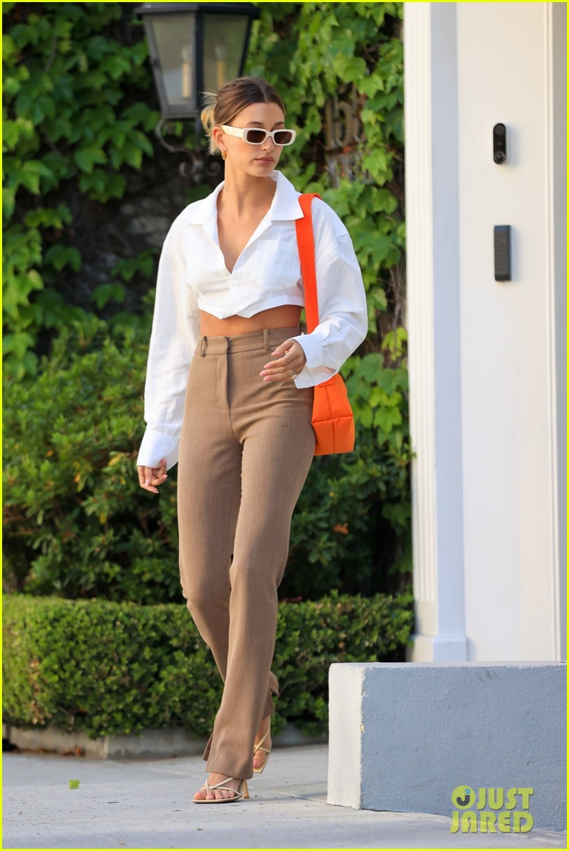 hailey bieber shows of toned midriff for business meeting 054552720